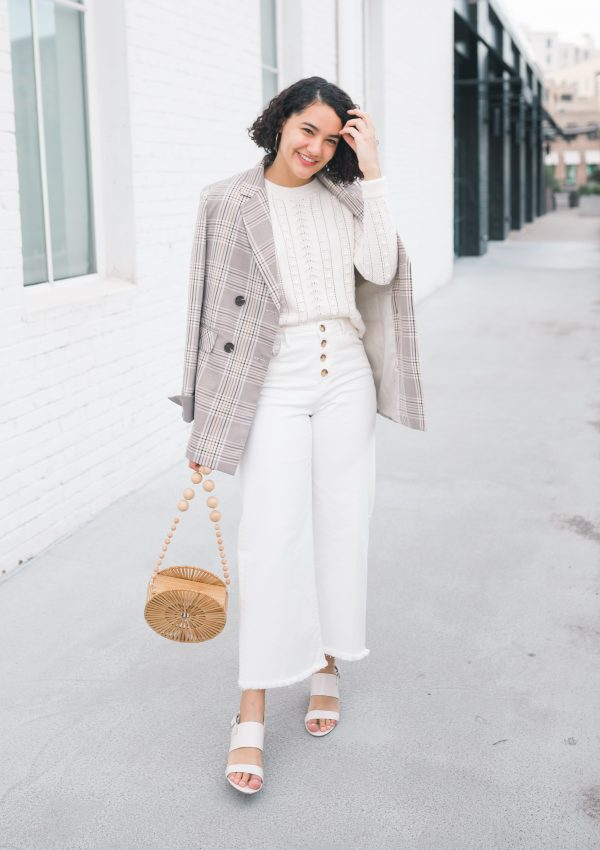 girl wearing a plaid blazer, white wide leg pants, white shoes, and a white sweater