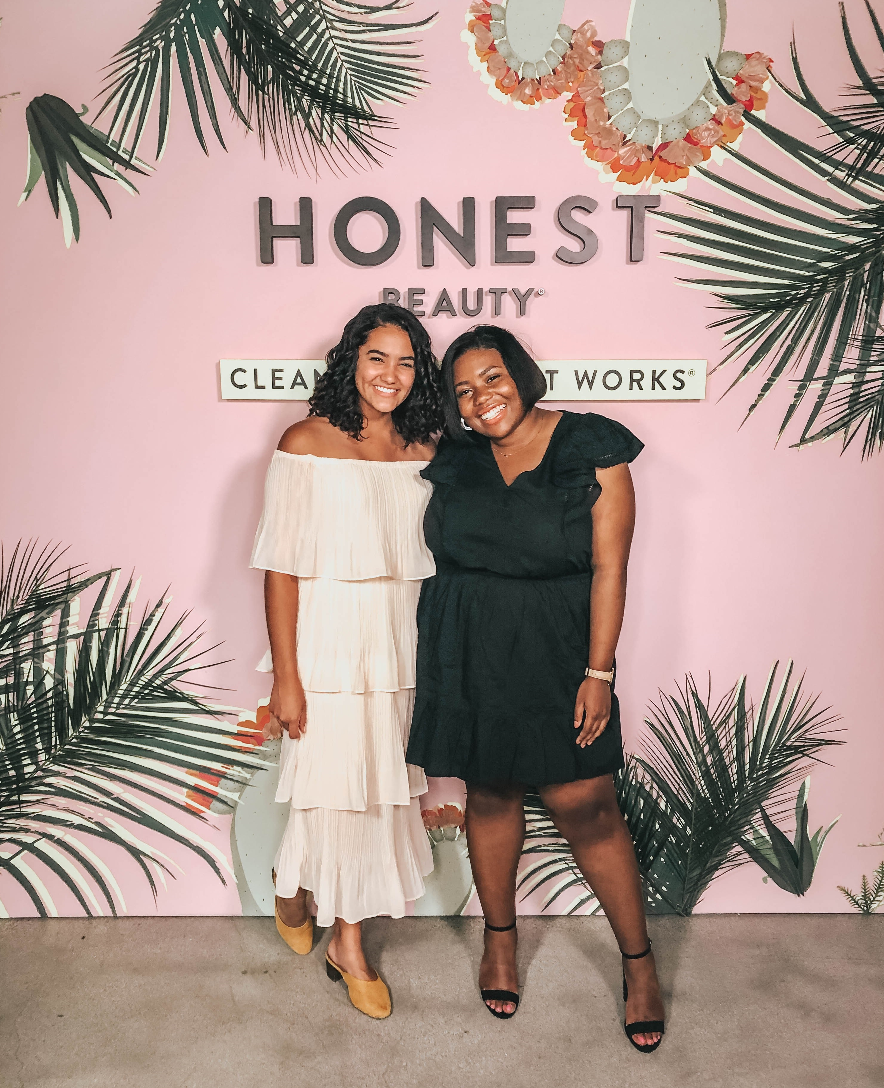 Two girls standing in front of an Honest Beauty Instagram moment