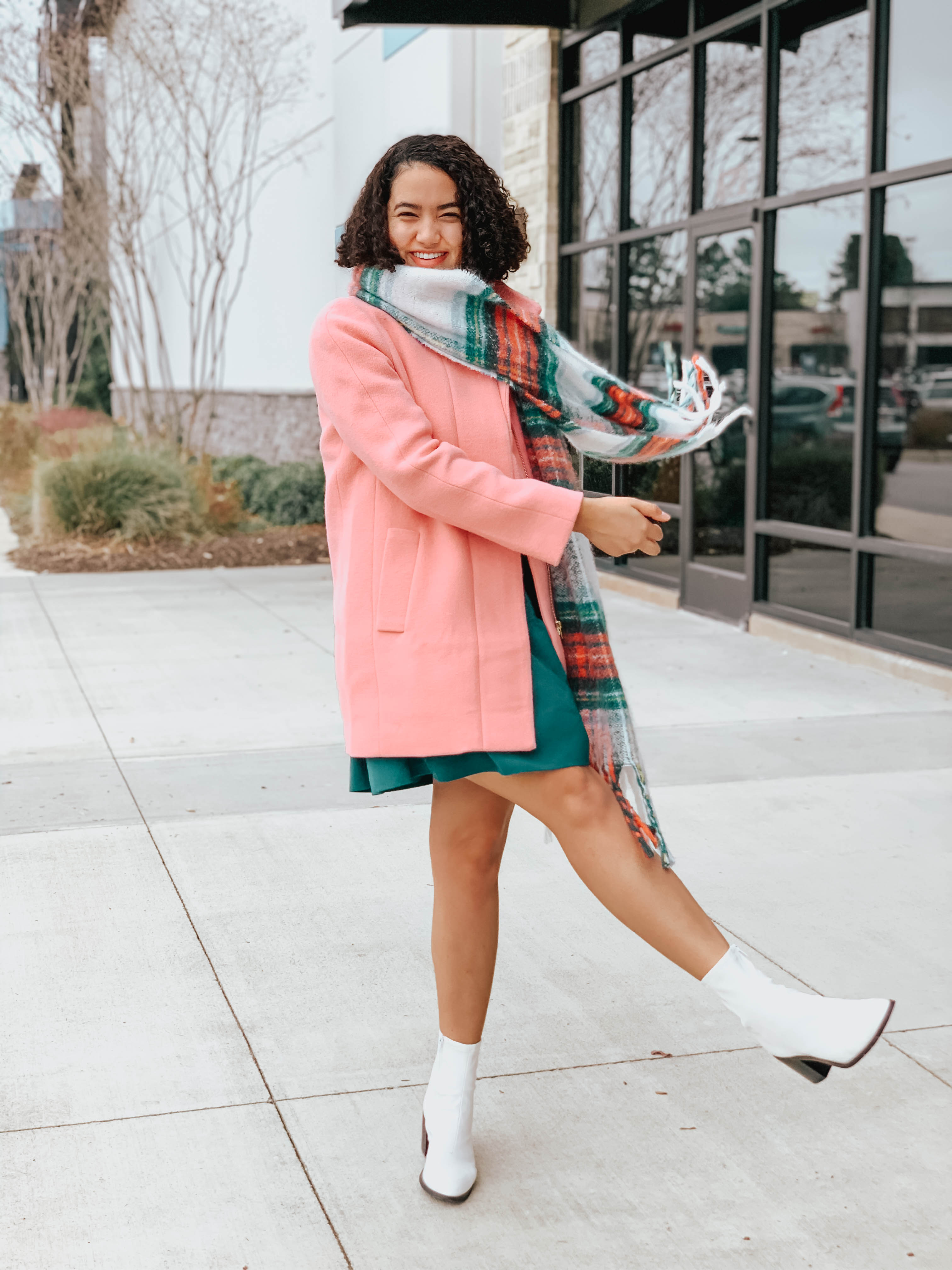 pink jacket-plaid scarf-teal ruffle hem dress-white boots-two